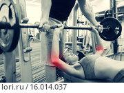 Купить «man and woman with barbell flexing muscles in gym», фото № 16014037, снято 30 ноября 2014 г. (c) Syda Productions / Фотобанк Лори