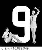 Купить «Hollywood, California: c. 1935.The number 9 accompanied by two attractive young women.», фото № 16082949, снято 10 декабря 2019 г. (c) age Fotostock / Фотобанк Лори