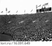 Купить «Chicago, Illinois: November 26, 1927.The scoreboard and crowd at halftime during the Notre Dame-USC football game at Soldiers Field. The Fighting Irish won the game by the same score.», фото № 16091649, снято 10 декабря 2019 г. (c) age Fotostock / Фотобанк Лори