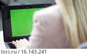 Купить «young businesswoman with laptop typing at office», видеоролик № 16143241, снято 8 ноября 2015 г. (c) Syda Productions / Фотобанк Лори
