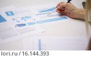 Купить «businesswoman or student with papers tablet pc», видеоролик № 16144393, снято 8 ноября 2015 г. (c) Syda Productions / Фотобанк Лори