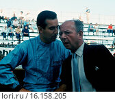 Lorenzo Bandini talking with Raymond Mays, father of the ERA and BRM projects at Monaco when Bandini drove a privately-entered BRM P578 run by the Scuderia Centro Sud team, 1963. Стоковое фото, фотограф GP Library \ UIG / age Fotostock / Фотобанк Лори
