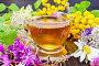 Чай из цветов в стеклянной чашкой на доске, фото № 16409121, снято 14 июля 2015 г. (c) Резеда Костылева / Фотобанк Лори