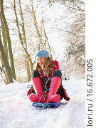 Купить «Woman Sledging Through Snowy Woodland», фото № 16672005, снято 3 июля 2020 г. (c) easy Fotostock / Фотобанк Лори