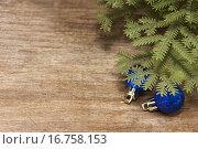 Купить «Деревянный фон с елочными шарами под елкой», фото № 16758153, снято 20 декабря 2015 г. (c) Наталья Осипова / Фотобанк Лори