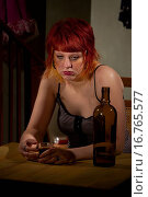 Купить «Underage alcoholic woman with bottle of wine», фото № 16765577, снято 21 февраля 2010 г. (c) easy Fotostock / Фотобанк Лори