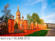 Купить «Red stone orthodox church with black cupolas», фото № 16848013, снято 22 сентября 2019 г. (c) easy Fotostock / Фотобанк Лори