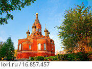 Купить «Red stone orthodox church with black cupolas», фото № 16857457, снято 22 сентября 2019 г. (c) easy Fotostock / Фотобанк Лори