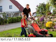 Купить «Father and daughter mowing lawn together», фото № 17065633, снято 25 мая 2018 г. (c) easy Fotostock / Фотобанк Лори