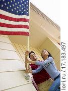 Купить «Raising the flag at home», фото № 17183497, снято 7 августа 2020 г. (c) easy Fotostock / Фотобанк Лори