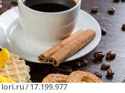 Купить «Biscuits and coffee on table», фото № 17199977, снято 18 ноября 2014 г. (c) Sergey Nivens / Фотобанк Лори