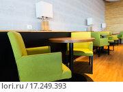 Купить «restaurant interior with tables and chairs», фото № 17249393, снято 5 ноября 2015 г. (c) Syda Productions / Фотобанк Лори
