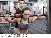 Купить «man and woman with barbell flexing muscles in gym», фото № 17251613, снято 30 ноября 2014 г. (c) Syda Productions / Фотобанк Лори