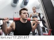 Купить «man and woman with barbell flexing muscles in gym», фото № 17251617, снято 30 ноября 2014 г. (c) Syda Productions / Фотобанк Лори