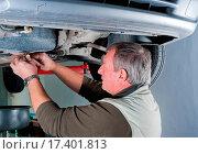 Купить «Car mechanic», фото № 17401813, снято 15 июля 2018 г. (c) easy Fotostock / Фотобанк Лори