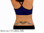 Купить «Female Lower Back with a Tattoo», фото № 17433745, снято 2 апреля 2020 г. (c) easy Fotostock / Фотобанк Лори