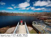 Купить «Man on boardwalk at waters edge in Manitoba», фото № 17435753, снято 27 июня 2019 г. (c) easy Fotostock / Фотобанк Лори
