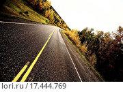 Купить «Centerlines along a paved road in autumn», фото № 17444769, снято 20 сентября 2019 г. (c) easy Fotostock / Фотобанк Лори
