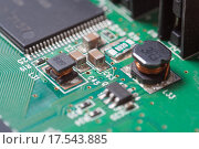 Купить «Компьютерная плата с чипом», фото № 17543885, снято 26 декабря 2015 г. (c) Алексей Букреев / Фотобанк Лори