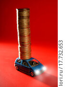 toy car with huge column of golden coins over red. Стоковое фото, фотограф TONO BALAGUER / easy Fotostock / Фотобанк Лори