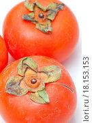 Купить «Orange persimmons isolated on white background», фото № 18153153, снято 22 июня 2018 г. (c) easy Fotostock / Фотобанк Лори