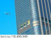 Купить «airplane fly over the modern building», фото № 18490949, снято 18 января 2019 г. (c) easy Fotostock / Фотобанк Лори