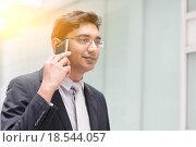 Купить «Asian Indian businessman on the phone», фото № 18544057, снято 15 октября 2019 г. (c) PantherMedia / Фотобанк Лори