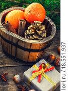 Купить «Wooden bucket with tangerines», фото № 18551937, снято 13 ноября 2019 г. (c) PantherMedia / Фотобанк Лори