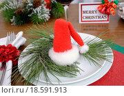 Купить «Christmas hat on a plate», фото № 18591913, снято 22 мая 2018 г. (c) easy Fotostock / Фотобанк Лори