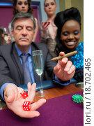 Купить «Man playing craps in casino», фото № 18702465, снято 23 октября 2018 г. (c) easy Fotostock / Фотобанк Лори