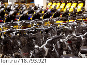 Купить «bicycles and scooter bikes rows in a renting shop», фото № 18793921, снято 23 июня 2018 г. (c) easy Fotostock / Фотобанк Лори