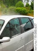 Купить «a car wash with a jet of water and shampoo», фото № 19000637, снято 25 мая 2018 г. (c) easy Fotostock / Фотобанк Лори