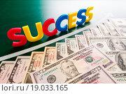 Купить «Colorful success words and growing US dollars», фото № 19033165, снято 20 сентября 2019 г. (c) easy Fotostock / Фотобанк Лори