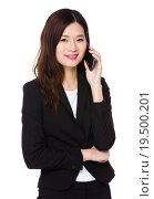 Купить «Asian Young businesswoman talk to cellphone», фото № 19500201, снято 17 января 2020 г. (c) PantherMedia / Фотобанк Лори