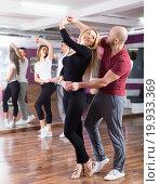 Купить «people having dancing class», фото № 19933369, снято 25 марта 2019 г. (c) Яков Филимонов / Фотобанк Лори
