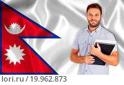 Купить «Male student of languages on Nepal flag», фото № 19962873, снято 13 сентября 2012 г. (c) easy Fotostock / Фотобанк Лори
