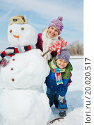 Купить «Happy beautiful children with snowman outside in winter time», фото № 20020517, снято 5 сентября 2013 г. (c) easy Fotostock / Фотобанк Лори