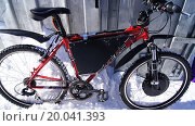 Купить «Электрический велосипед зимой», фото № 20041393, снято 9 марта 2013 г. (c) Максим Терновский / Фотобанк Лори