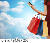 Купить «close up of woman with shopping bags and bank card», фото № 20087265, снято 28 октября 2012 г. (c) Syda Productions / Фотобанк Лори