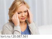 Купить «unhappy woman suffering from headache at home», фото № 20087561, снято 27 ноября 2015 г. (c) Syda Productions / Фотобанк Лори