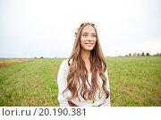Купить «smiling young hippie woman on cereal field», фото № 20190381, снято 27 августа 2015 г. (c) Syda Productions / Фотобанк Лори