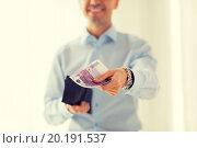 Купить «close up of businessman hands holding money», фото № 20191537, снято 13 ноября 2014 г. (c) Syda Productions / Фотобанк Лори