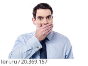 Купить «Shocked man covering mouth with hand», фото № 20369157, снято 2 декабря 2014 г. (c) easy Fotostock / Фотобанк Лори