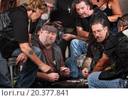 Купить «Serious gang members playing cards and drinking», фото № 20377841, снято 30 июня 2012 г. (c) easy Fotostock / Фотобанк Лори