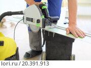 Купить «Man uses a submersible circular saw for cutting boards», фото № 20391913, снято 22 апреля 2014 г. (c) Losevsky Pavel / Фотобанк Лори