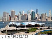 Купить «Cityscape of skyscrapers and hangars near the river.», фото № 20392153, снято 4 сентября 2014 г. (c) Losevsky Pavel / Фотобанк Лори