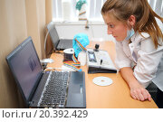 Купить «Doctor looks attentively at a computer screen with the results of changes in the activity of the brain of the patient», фото № 20392429, снято 19 июня 2014 г. (c) Losevsky Pavel / Фотобанк Лори