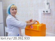 Купить «MOSCOW - JUNE 27, 2014: Nurse in hat and orange chest, focus on chest in Scientific-practical center of medical care for children with developmental disabilities, craniofacial and congenital diseases of the nervous system», фото № 20392933, снято 27 июня 2014 г. (c) Losevsky Pavel / Фотобанк Лори