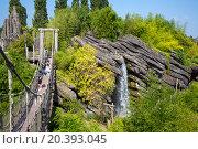 Купить «FRANCE, PARIS - 10 SEP, 2014: Waterfall and suspension bridge in Pirates beach on Disneyland.», фото № 20393045, снято 10 сентября 2014 г. (c) Losevsky Pavel / Фотобанк Лори