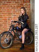 Купить «Beautiful girl is sitting on the black bike in front of bricks wall.», фото № 20393297, снято 7 ноября 2014 г. (c) Losevsky Pavel / Фотобанк Лори